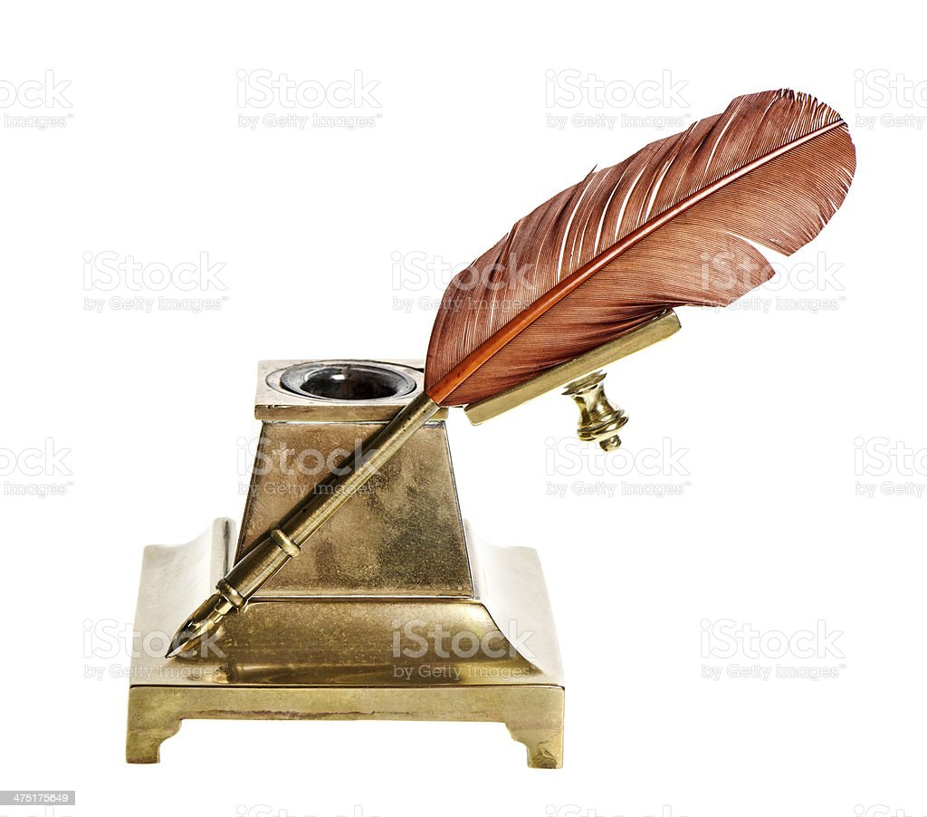 Feather pen with antique inkwell Isolated on white royalty-free stock photo