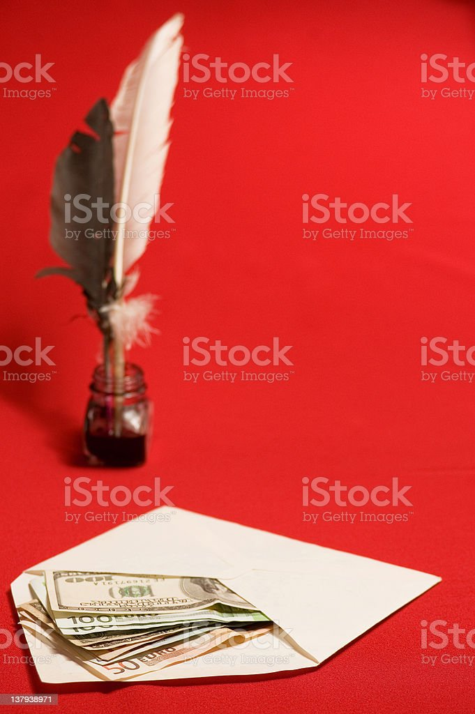 Feather quill, ink and money royalty-free stock photo