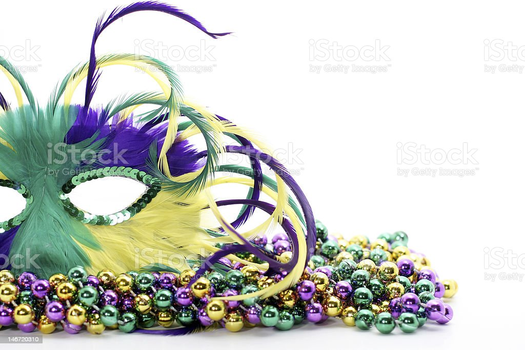feathered mask on beads stock photo
