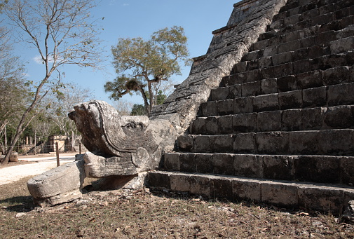 Feathered stone serpent of Osario Pyramid, at Chichen Itza, Mexico