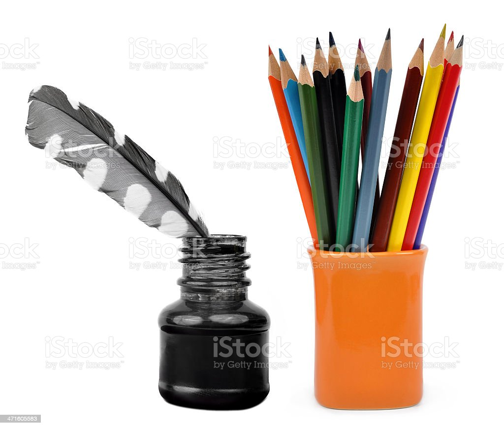 Feathers in ink bottle and color pencils royalty-free stock photo