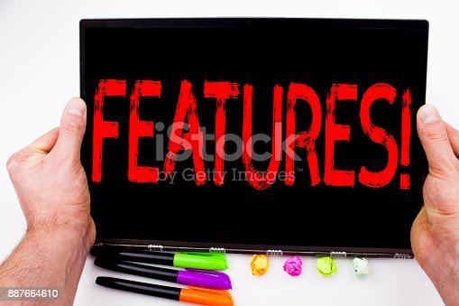 istock Features text written on tablet, computer in the office with marker, pen, stationery. Business concept for Advertisement Advertising white background with copy space 887664610