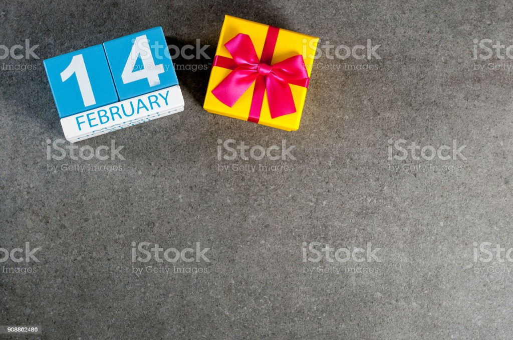 February 14th. Day 14 of february month, calendar on dark background with gift box. Saint Valentine's days. Empty space for text, mockup stock photo