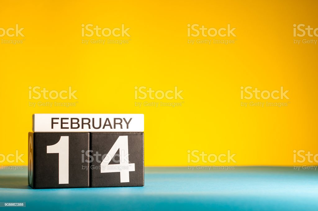 February 14th. Day 14 of february month, calendar on yellow background. Saint Valentine's days. Empty space for text, mockup stock photo