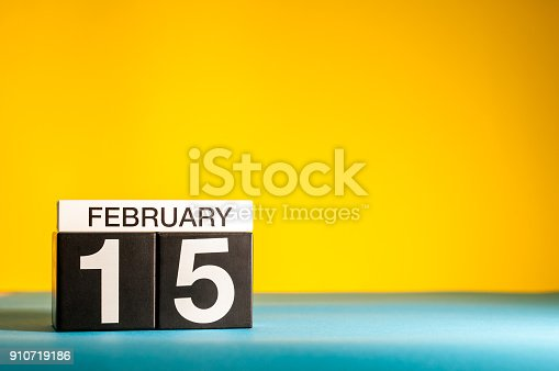 istock February 15th. Day 15 of february month, calendar on yellow background. Winter time. Empty space for text 910719186