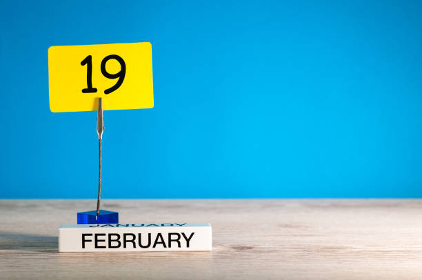february 19th. day 19 of february month, calendar on little tag at blue background. winter time. empty space for text, mockup - number 19 stock photos and pictures