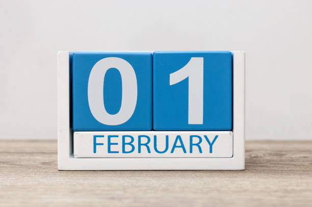 february 1st. day 1 of month, calendar on white background. winter time - february stock photos and pictures