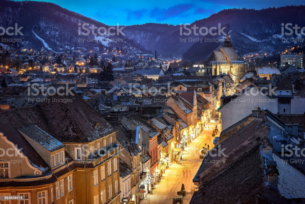 BRASOV, ROMANIA - 4 February 2015:Night image of the old town and City Hall square of Brasov.Panoramic view of the BRASOV old  in Transylvania,Romania stock photo