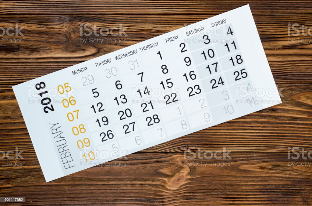 february 2018 calendar on wooden table royalty free stock photo