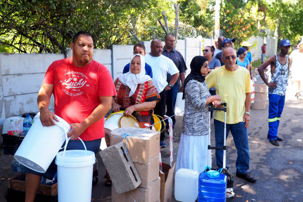 8 February 2018 - Cape Town, South Africa : Capetonians queue for water as their taps threaten to run dry. stock photo