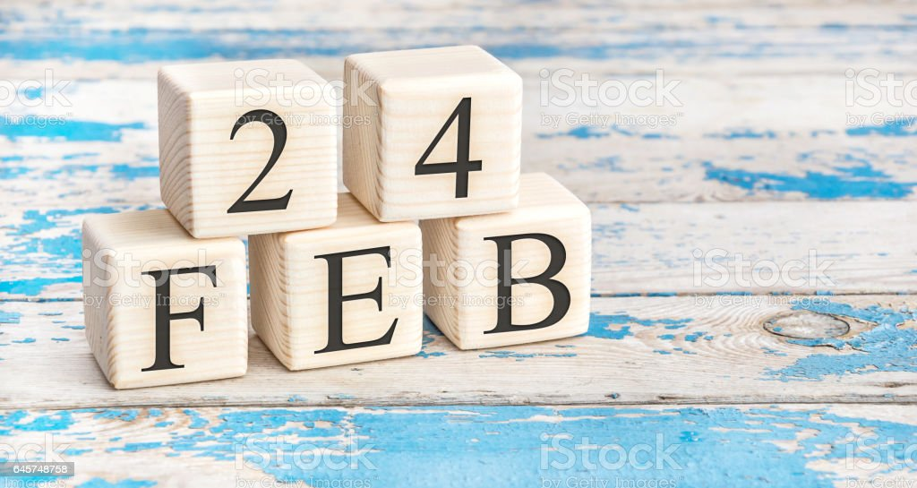 February 24th. Wooden cubes with date of 24 February. stock photo