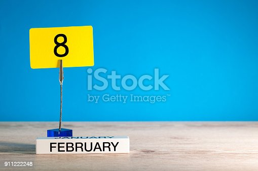 968874704istockphoto February 8th. Day 8 of february month, calendar on little tag at blue background. Winter time. Empty space for text, mockup 911222248