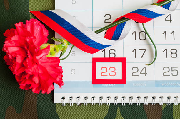 23 february festive card. red carnation, russian flag and calendar - number 23 stock photos and pictures
