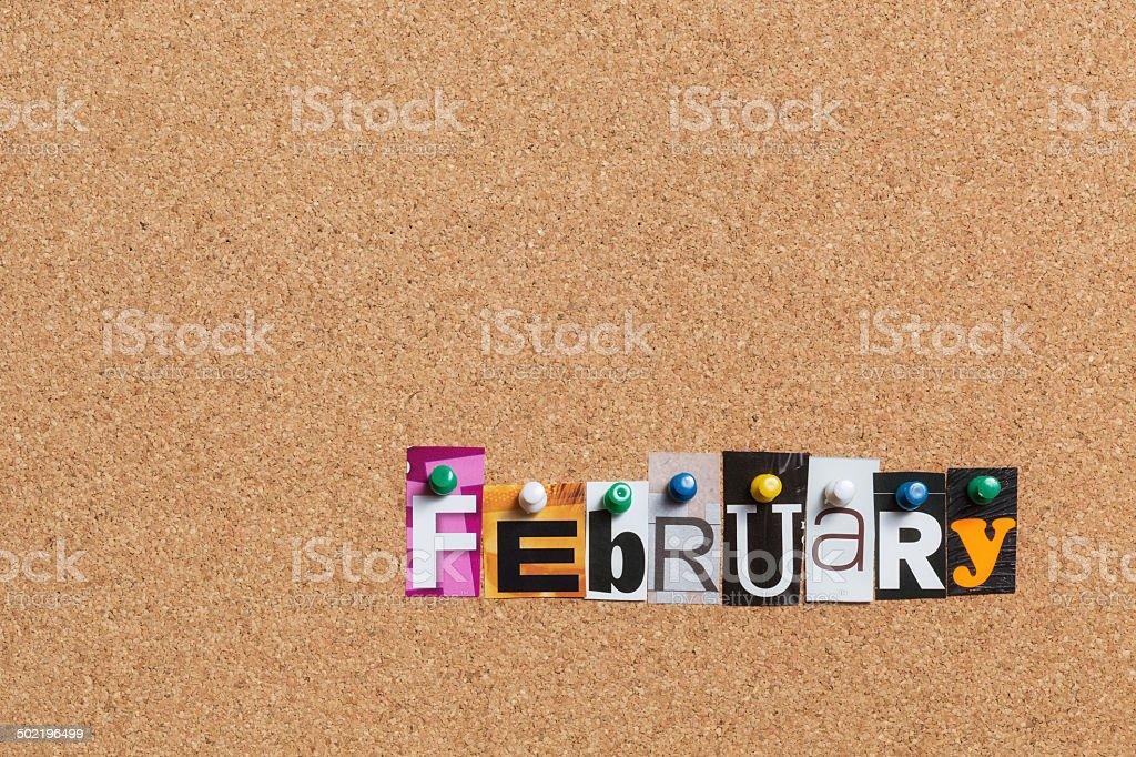 February pinned on bulletin cork board royalty-free stock photo