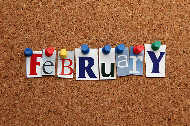 february pinned on noticeboard - february stock photos and pictures