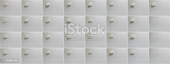 istock February set: Calendar date on a yellow sticky note with copy space on white background. 1125068769