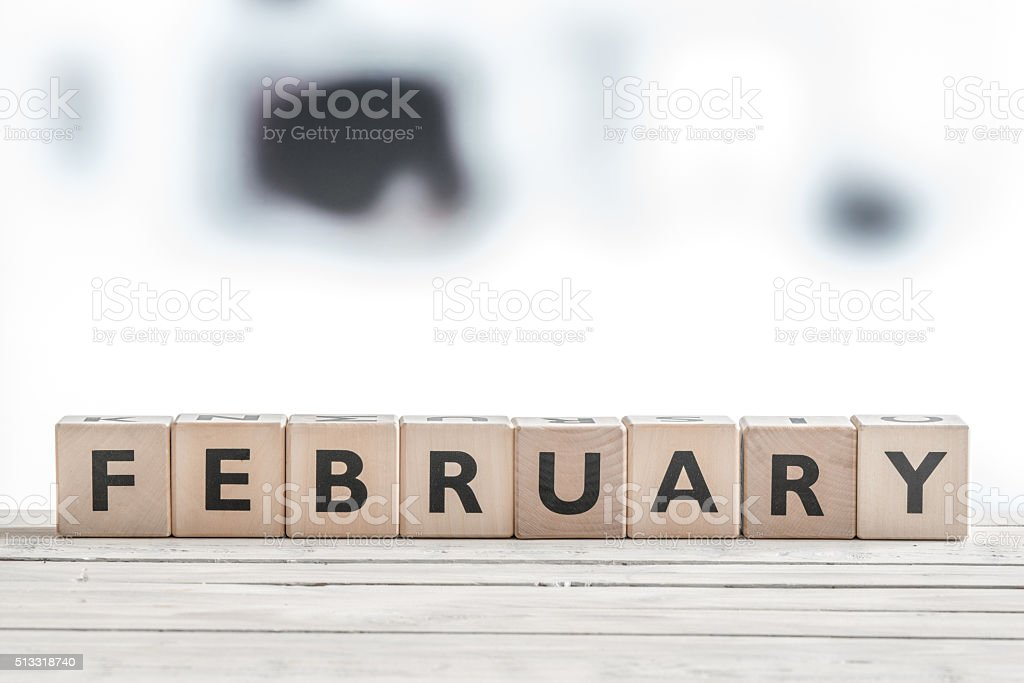February sign on wooden blocks