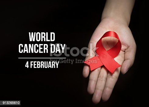 istock 4 February , World Cancer Day with ribbon on human hand for campaign poster about cancer 913265610