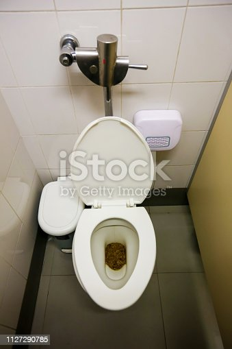 istock Feces in public toilet, Users who forget to flush the toilet.Dirty toilet in a house.Dirty old toilet bowl. 1127290785