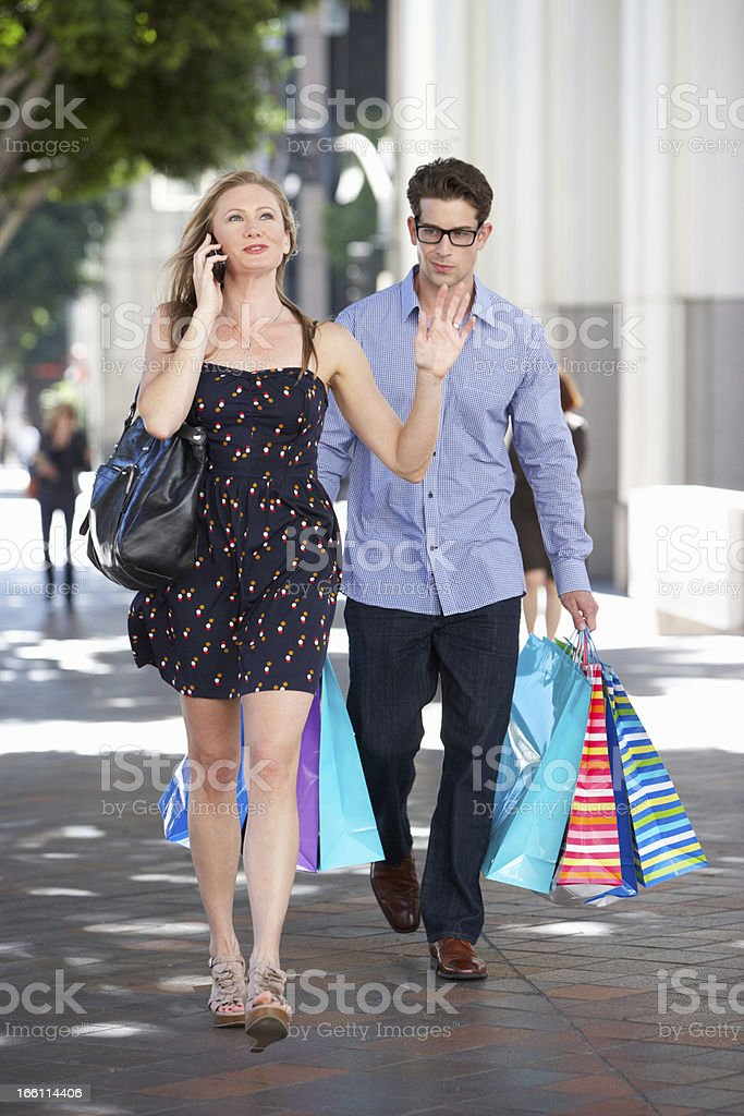 Fed Up Man Carrying Partners Shopping Bags royalty-free stock photo