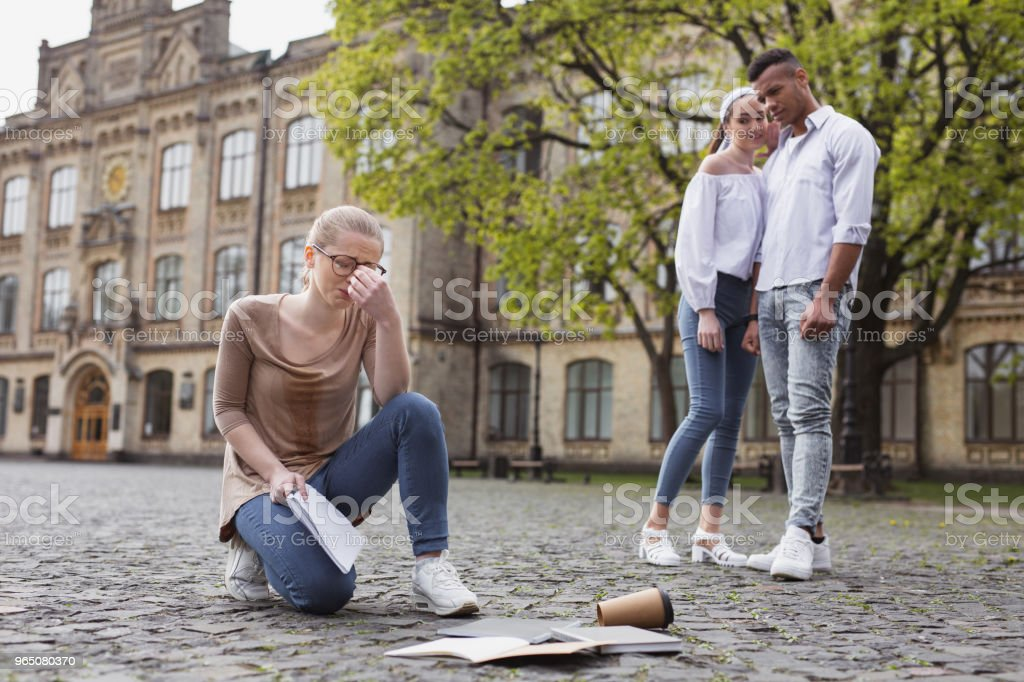 Fed up student crying while dropping her things on the ground zbiór zdjęć royalty-free