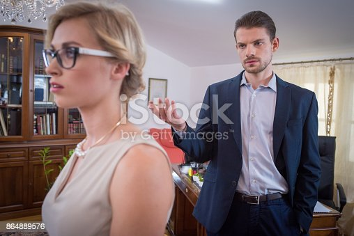 istock Fed up woman looking away as a man scolds her 864889576