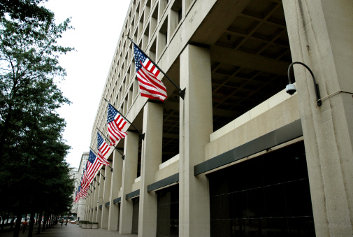 J Edgar Hoover building with flags