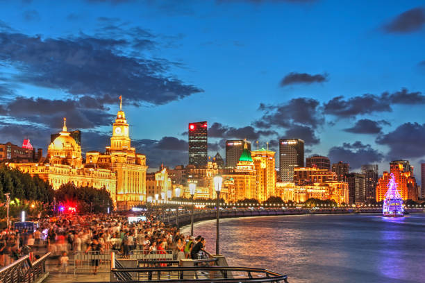 Federal Government, Shanghai, China Night scene along the Bund in Shanghai, China, featuring most of the iconing collonial buildings facing the Huangpu River. the bund stock pictures, royalty-free photos & images