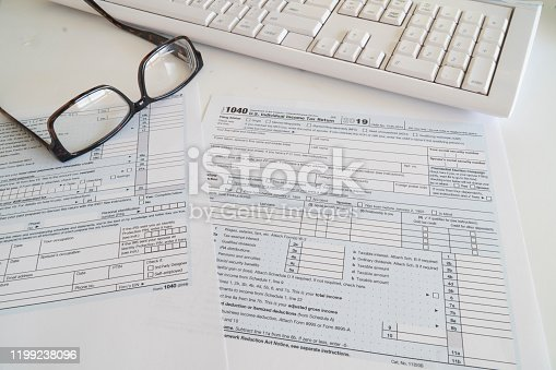 1136634036 istock photo Federal income tax preparation with 1040 form to be sent by April 15 . 1199238096