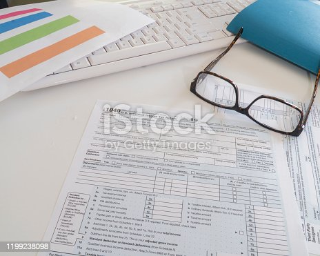 1136634036 istock photo Federal income tax preparation with 1040 form to be sent by April 15 . 1199238098
