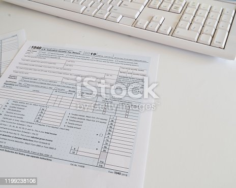 1136634036 istock photo Federal income tax preparation with 1040 form to be sent by April 15 . 1199238106