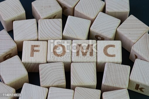 istock FOMC, Federal Open Market Committee concept, cube wooden block with alphabet building the word FED at the center on dark blackboard background, the institution to control US financial banking 1140124803