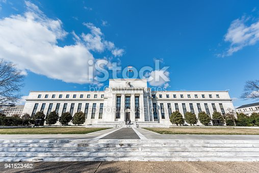 istock Federal Reserve bank entrance wide angle architecture building wall security guard doors, path, american flags, blue sky 941523462