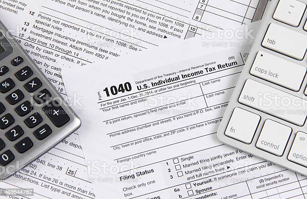 Federal Tax Form 1040 With Keyboard And Calculator Stock Photo - Download Image Now