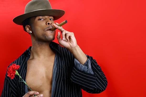 fedora, nelke, und zigarren - pimp stock-fotos und bilder