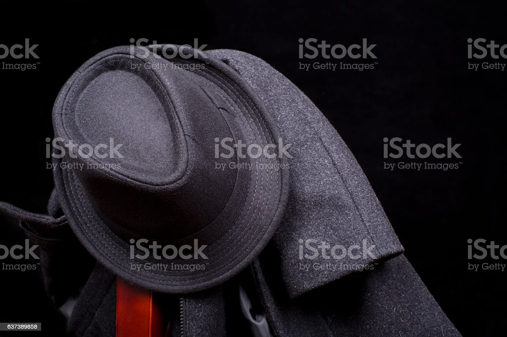 Fedora hat and tweed coat on chair stock photo