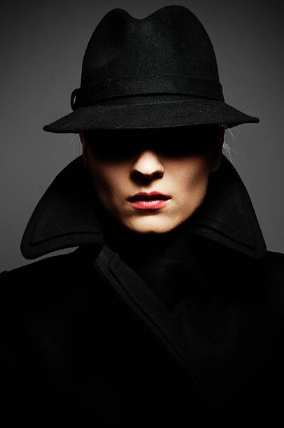 fedora - female spy stock photos and pictures