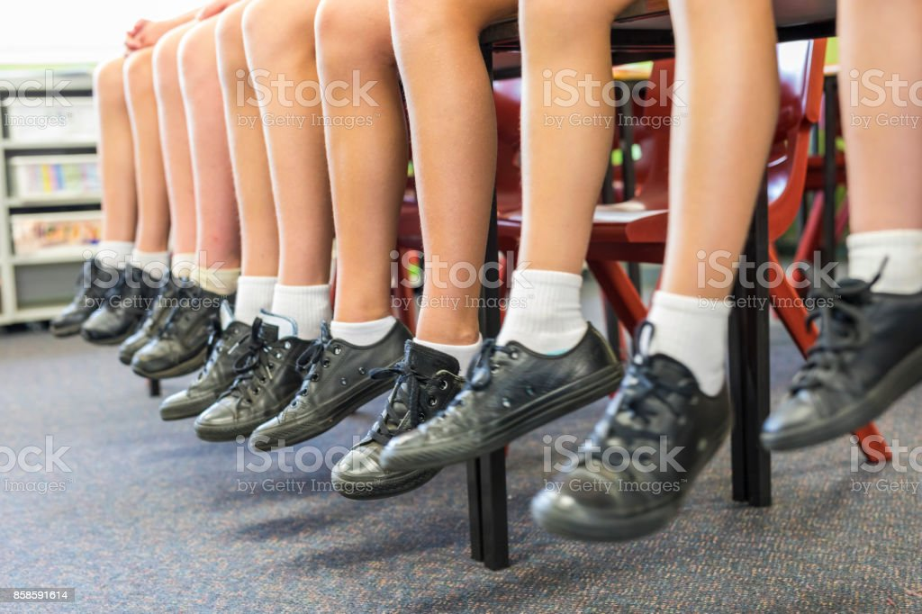 Feed of Primary School Students Sitting stock photo