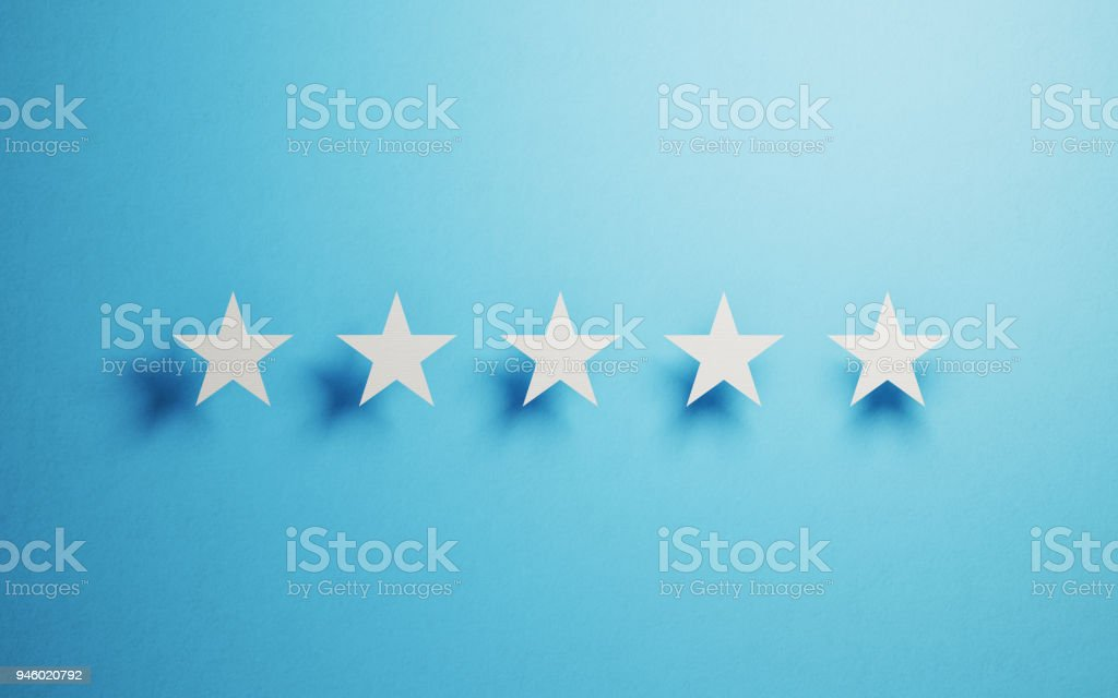 Feedback Concept White Cut Out Star Shapes Over Blue Background
