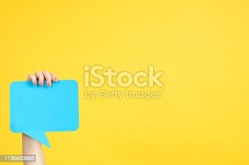 istock feedback hand hold speech bubble copy space 1130633985