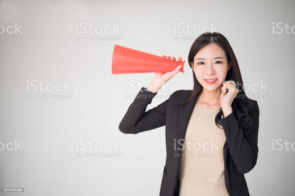 Feedback, Survey, Comment, Opinion concept background with asian woman hold red speaker cone. Customer feedback or comment and marketing survey is the part of business development. stock photo