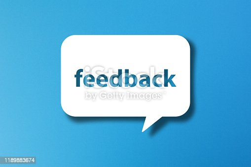 Feedback word with speech bubble on blue background