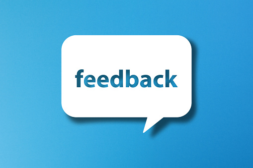istock Feedback word with speech bubble on blue background 1189883674
