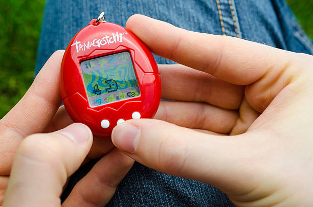 Feeding a Tamagotchi stock photo