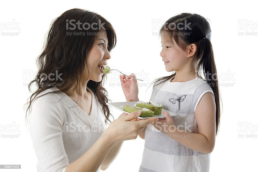 Feeding cake for mama royalty-free stock photo