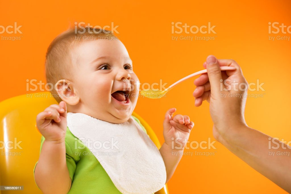 Feeding excited baby stock photo