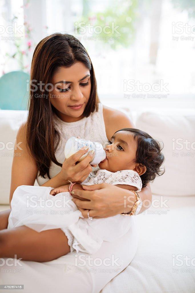 Feeding her daughter stock photo