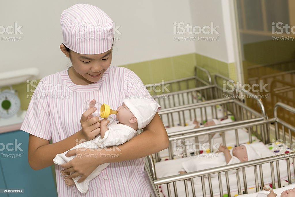 Feeding newborn stock photo