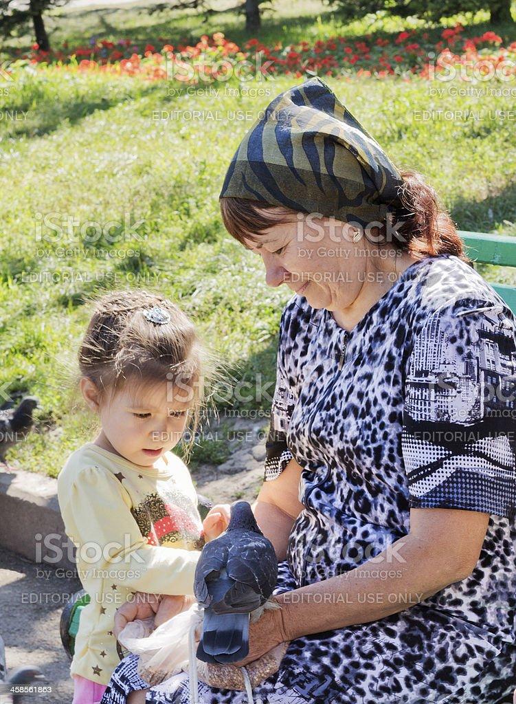 Feeding Pigeons, Almaty, Kazakhstan royalty-free stock photo