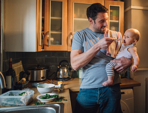 Feeding The Baby Stock Photo - Download Image Now
